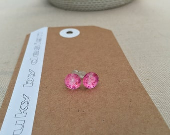 Stud earrings. 8mm. Bold, bright, unique, fun, eye-catching, cute. Sparkly pink.