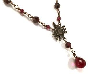 Garnet Y necklace with pierced heart centerpiece