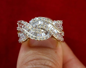 14 kt Gold and diamond Baguette Braid Ring