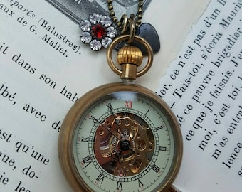 BODIE – Mechanical working pocket watch pendant suspended from a brass oxidized faceted ball chain.
