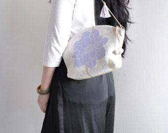 Flower season tassel shoulder bag. woman clutch