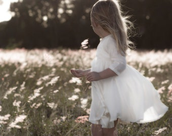 Fine Art Photography Print of a Small Girl in a Field of Wild Grass and Wildflowers