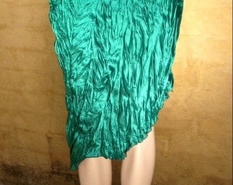 Crinkle satin bias cut skirt with angle rolled hemline. In forest green. Size Medium (Aust 12).