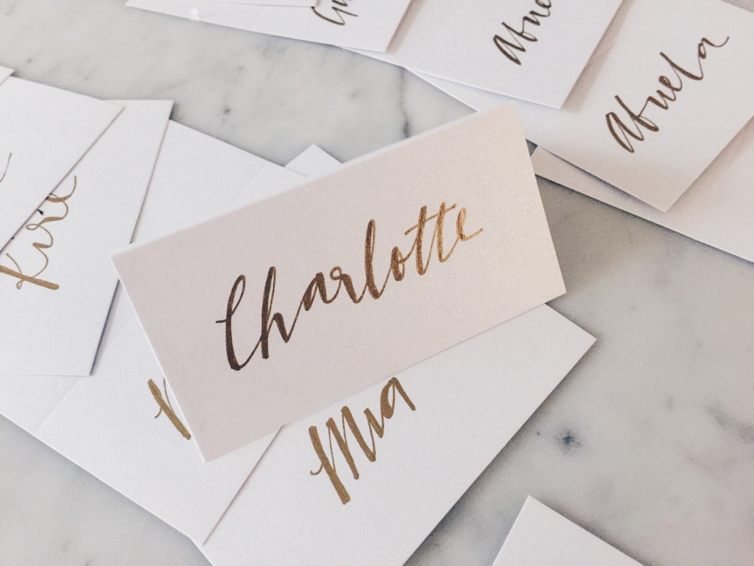 Custom hand drawn metallic gold lettering sign name for Wedding place name cards