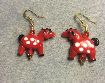 Opaque red with white spots lampwork horse bead earrings adorned with red Czech glass beads.