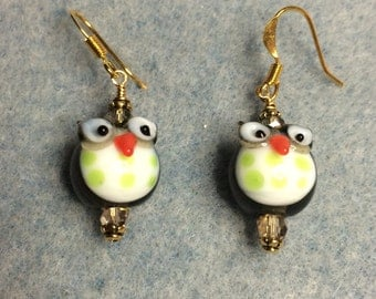 Charcoal gray with green polka dots round lampwork owl bead earrings adorned with gray Chinese crystal beads.