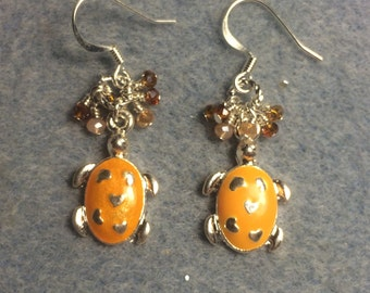 Small tangerine enamel turtle charm dangle earrings adorned with tiny tangerine and orange Chinese crystal beads.