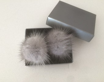 Sapphire Mink pompom clips, a pair of mink pompoms suitable to clip them in shoes, shirts and more.