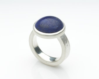 Silver and lapis lazuli ring on a hammered silver band, texured silver