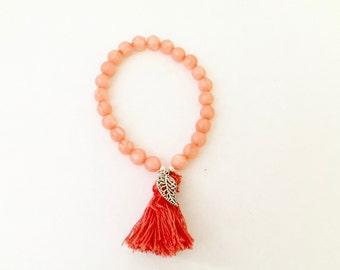 Salmon color bracelet/Stretch Peach Bracelet/Bead Bracelet/Leaf Charm Bracelet/Boho Bracelet/Tassel Bracelet
