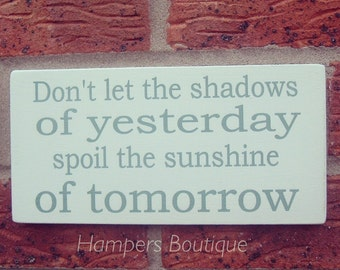 Don't let the shadows of yesterday plaque