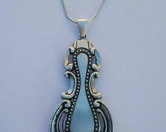 Vintage sterling silver pendant on silver snake chain