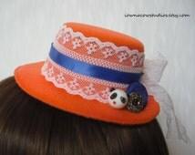 panda mini top hat fascinator in orange
