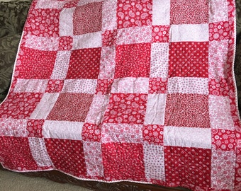 Red and White Floral Quilt