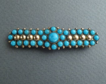 Gold and turquoise brooch