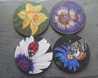 New set of spring flowers with butterflys and ladybird coasters .  set of 4.