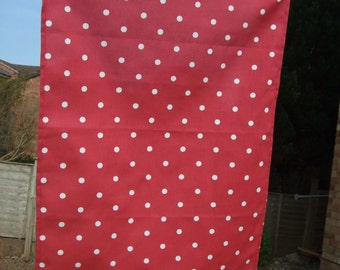 A stylish organic cotton  tea towel / kitchen towel in red dotty design