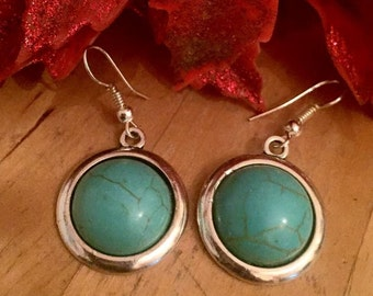 Turquoise blue howlite round silver dangly earrings