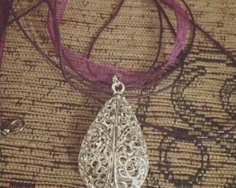 Silver filigree teardrop pendant on purple organza ribbon necklace