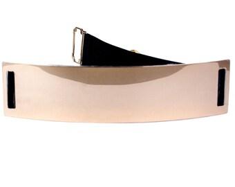 Metal belt with elastic rear