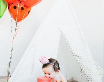 Ivory teepee play tent with gold polka dot accents