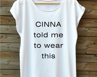 Hunger Games. CINNA told me. Oversize fashionable women's t-shirt. Very soft. Combed cotton. White blouse. Short sleeve.