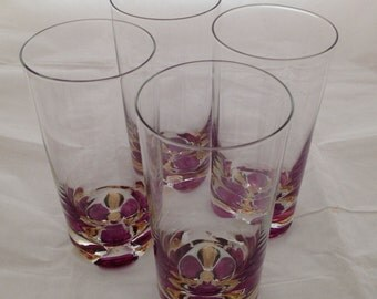 Set of Four Glass Tumblers with Purple and Gold Flower Pattern in the Bottom