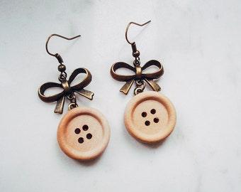 Light button earrings