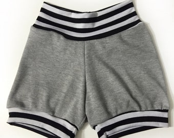 Grey jogger shorts with black and white stripe cuffs