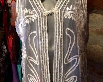 1980-90's translucent beaded, with cord edging evening vest. Size M/L.