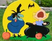 Witch on Halloween pumkins