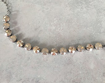 Golden shadow and sand opal swarovski crystal bracelet in antique silver setting