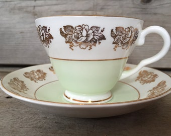Delicate mint green and gold Crownford teacup and saucer set