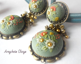 "jewelry set made of polymer clay.""floral filigree""Earrings and a ring."