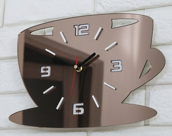 large wall clock, brown mirror, clock cup