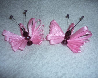 "Two pink 2.5"" wide hair clips butterflys"