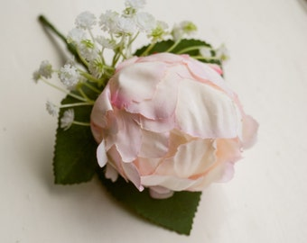 Blush pink silk wedding buttonhole / boutineer. Made from an artificial peony, a gypsophilia cluster and simple greenery.