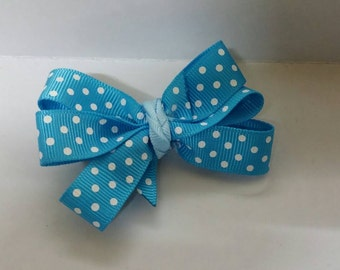 Blue Polkadot Pinwheel Hair Bow on a lined Alligator clip