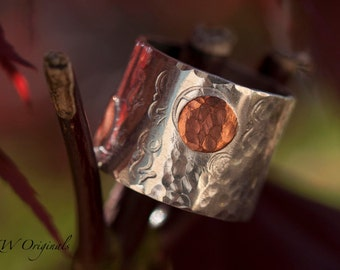 Sterling silver band with copper discs