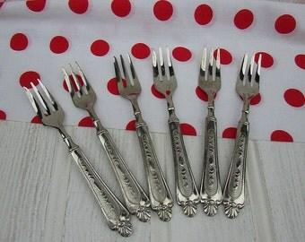 Ornate Silver Dessert Forks