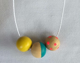 Wooden bead necklace // blue, pink and yellow // hand painted