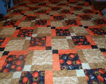 Beautiful Basketball quilt in orange and wood look floor