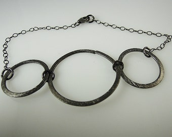 Bracelet with 3 Black Oxidized Sterling Silver Rings
