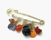 shawl pin beaded in amber,carnelian and black on gold tone kilt pin