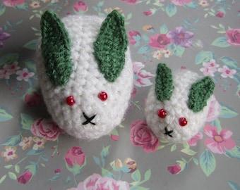 1 pair of crochet amigurumi snow bunnies with red bead eyes