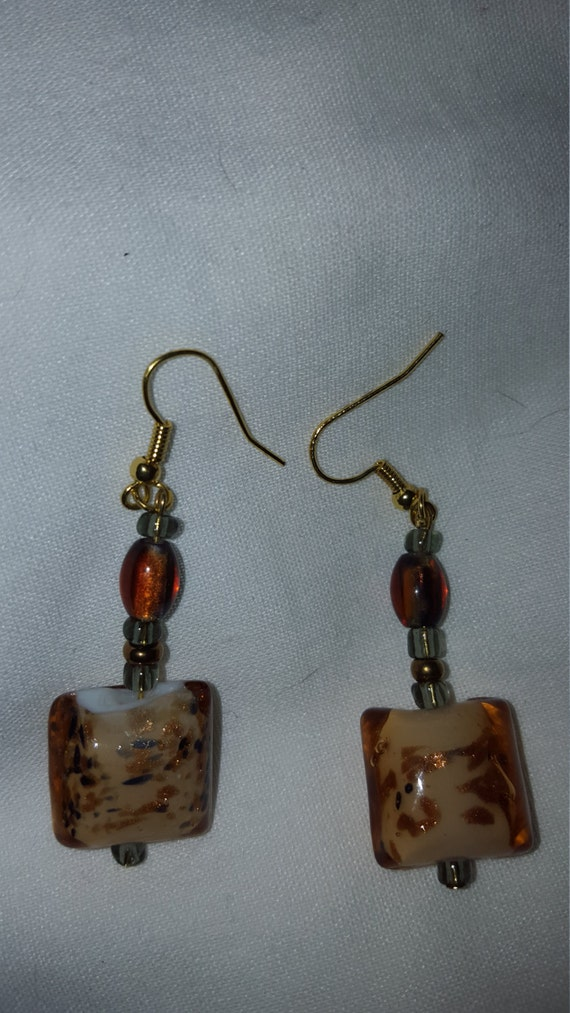 Gold and amber color glass bead earrings