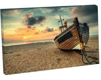 Beautiful sunrise old wooden fishing boat on pebble beach Print on canvas XT2547