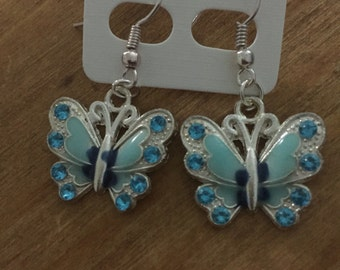 Blue butterfly dangle earrings