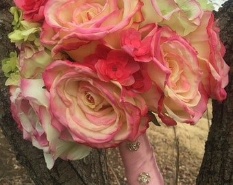Pink roses, brides bouquet stems wrapped in pink silk ribbon