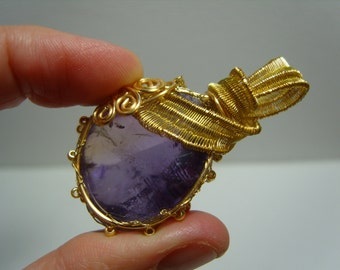 Beautiful Amethyst knitted gold plated wire pendant